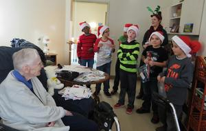 Page students sing Christmas carols to residents at Carveth Village.