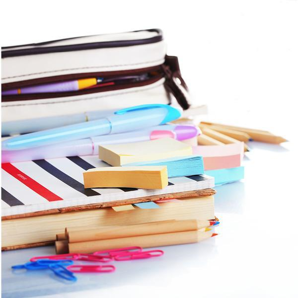 Books and school supplies against a white background