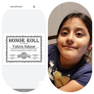 Valeria holding honor roll certificate