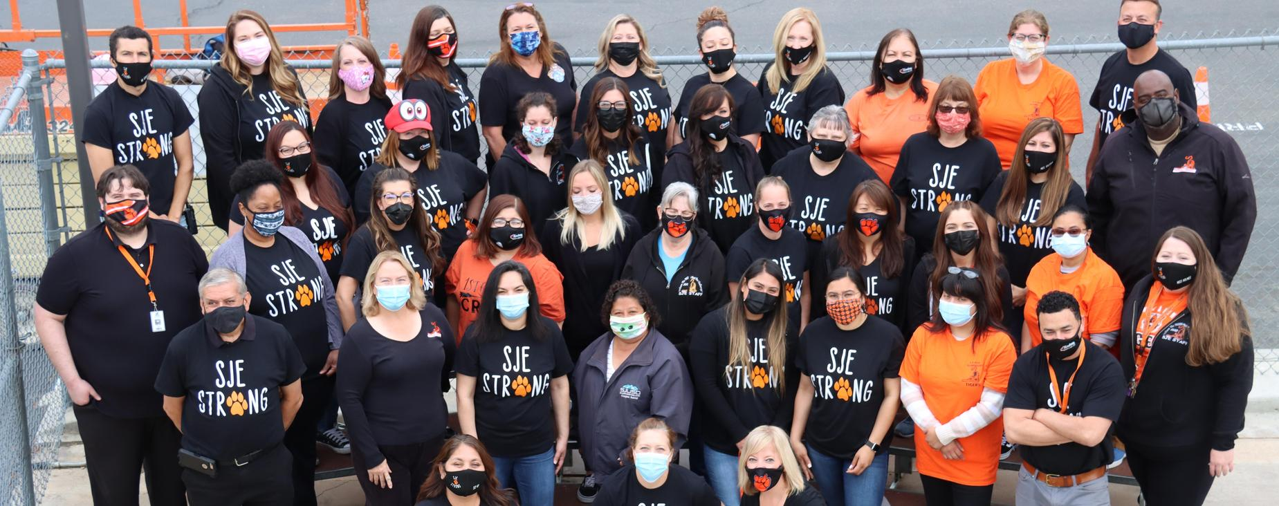 Aerial photo of SLE Staff wearing black SJE strong Photo