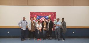 Chaparral Hills Elementary faculty members posing with Math Night backdrop