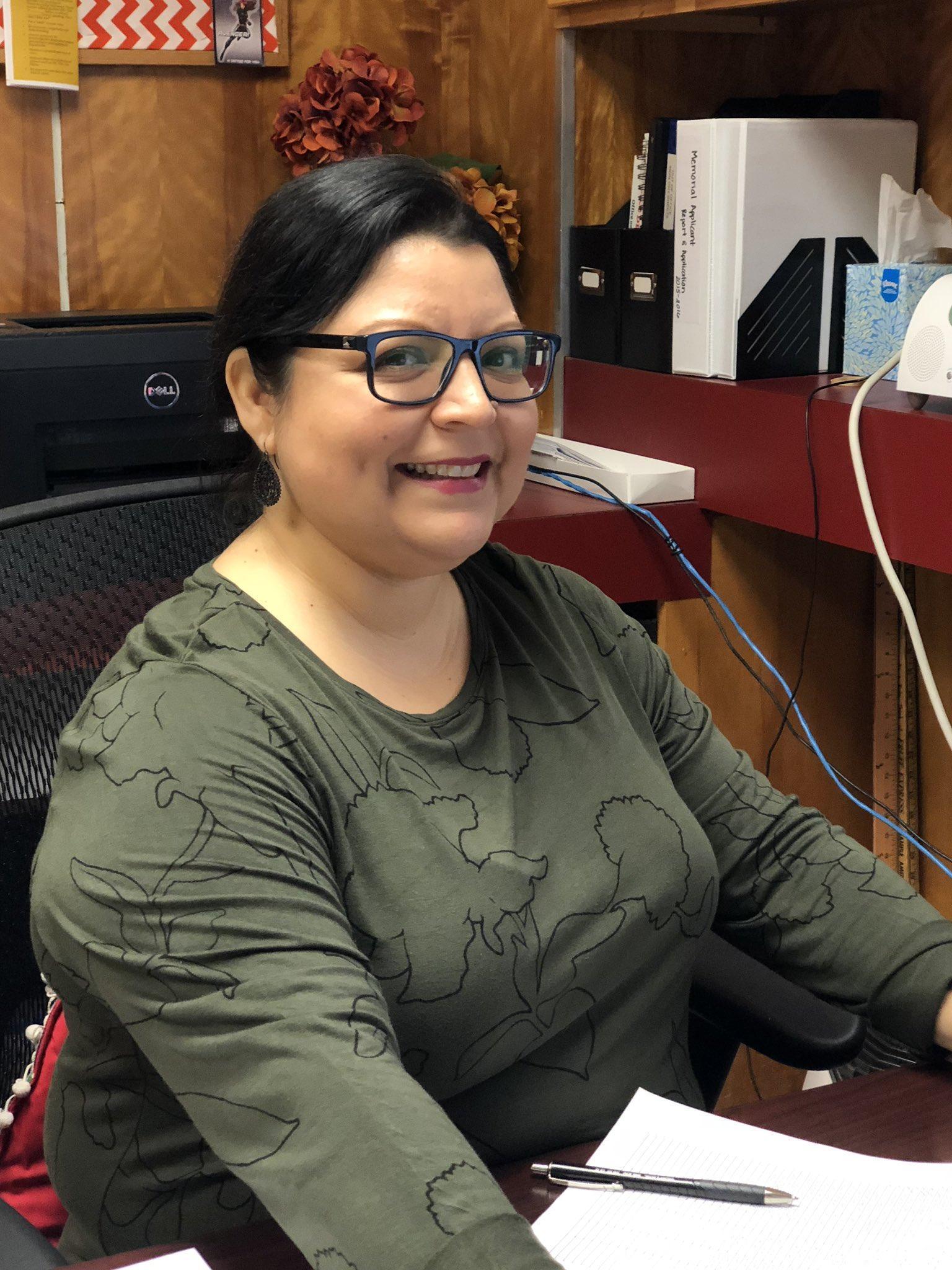 secretary smiling for the camera