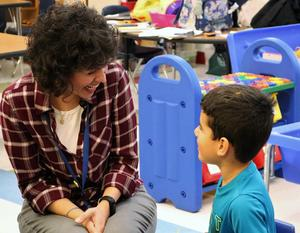 Photo of Lincoln teacher and student exchanging compliments during the Week of Respect.
