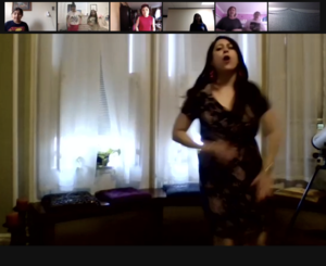 Ms. Silvia dancing and talking on zoom