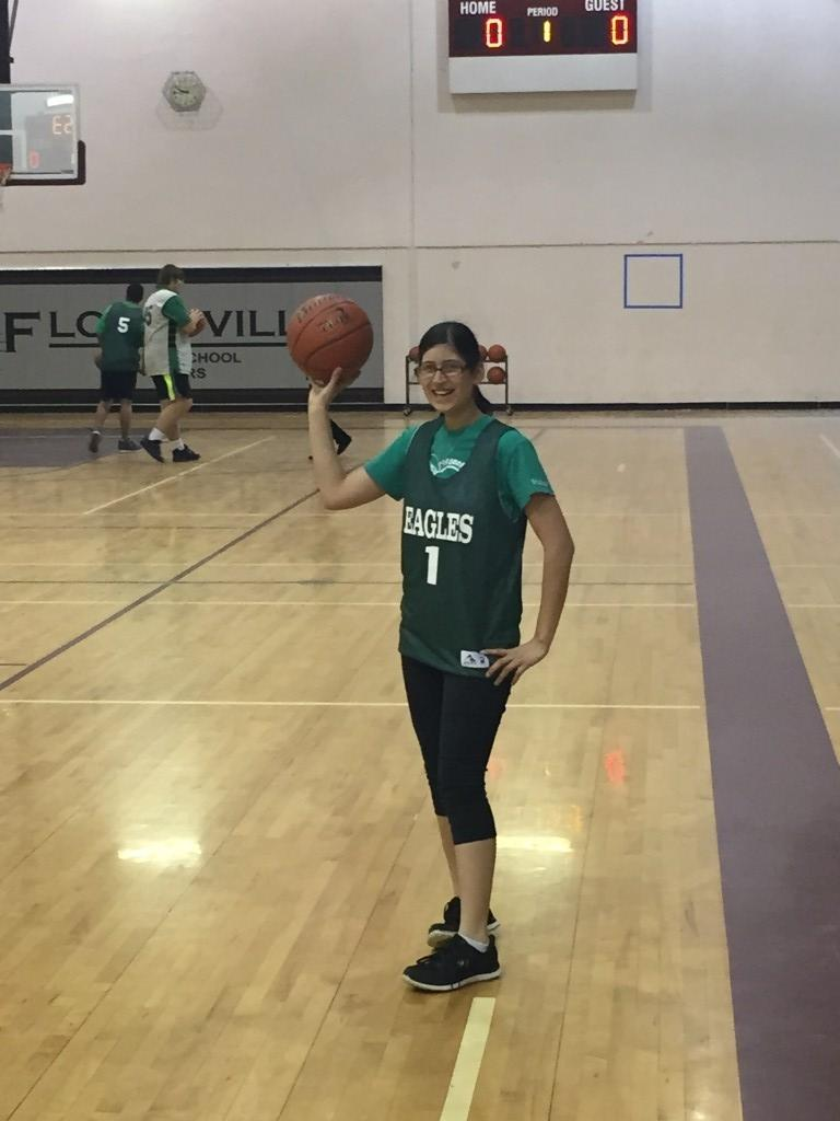Posing with a basketball
