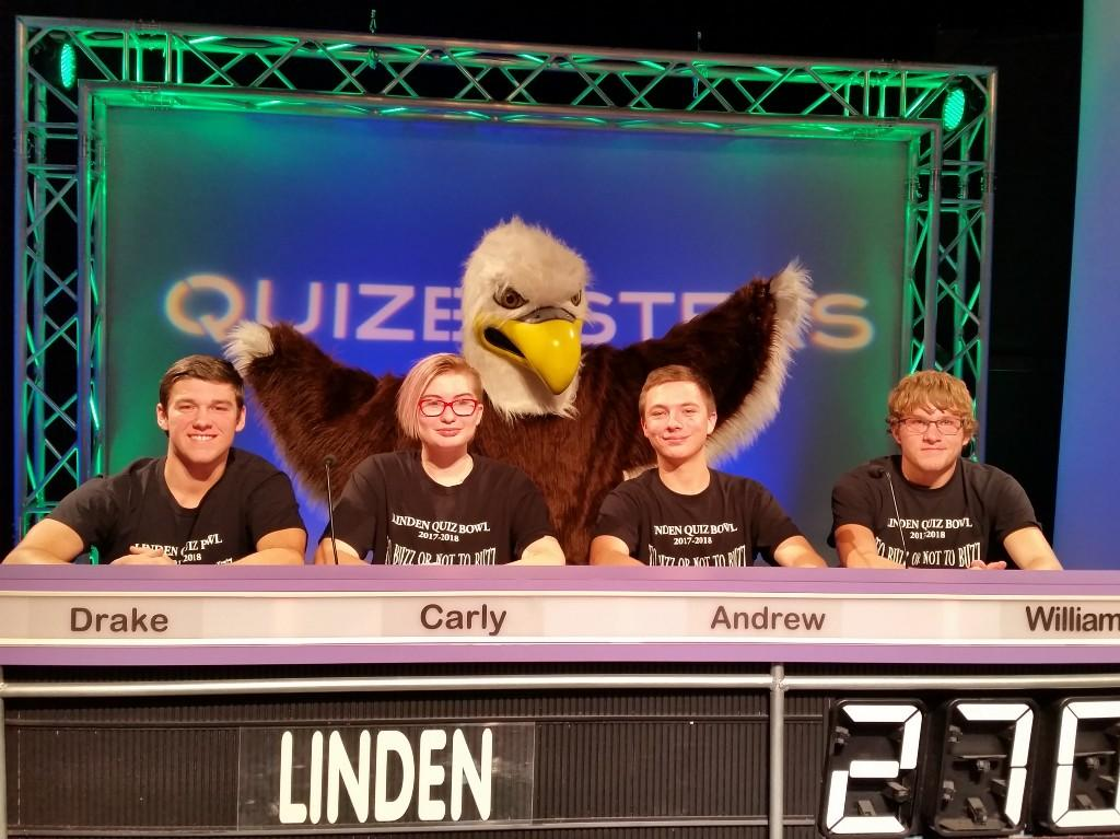 Students on television set with eagle mascot behind them