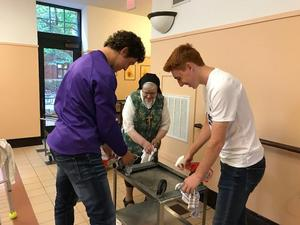photo of students helping a Sister