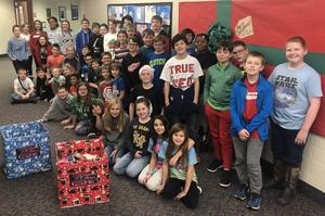 Fifth graders posing with their donation boxes