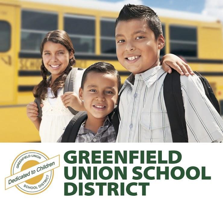 3 Students standing in front of a yellow school bus