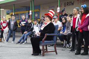 Maria Fernandez in front of students and staff