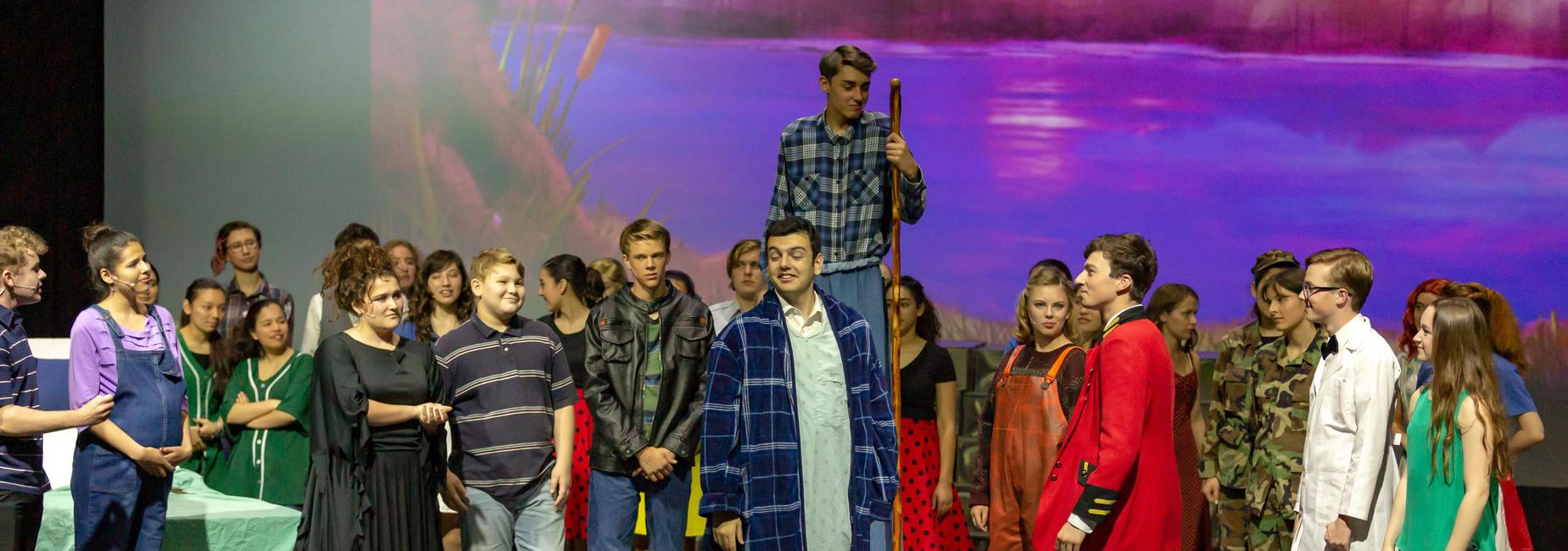 Cast of musical Big Fish performing onstage