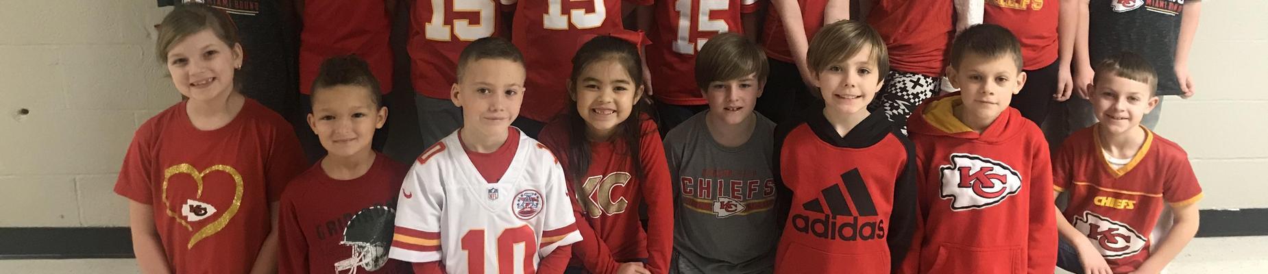9 Children in Chiefs apparel