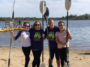 Students and students with oars at Camp Duncan