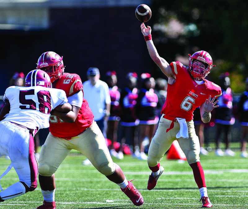 Quarterback Duke Doherty throws the ball down field during the 2019 game vs. Brockton