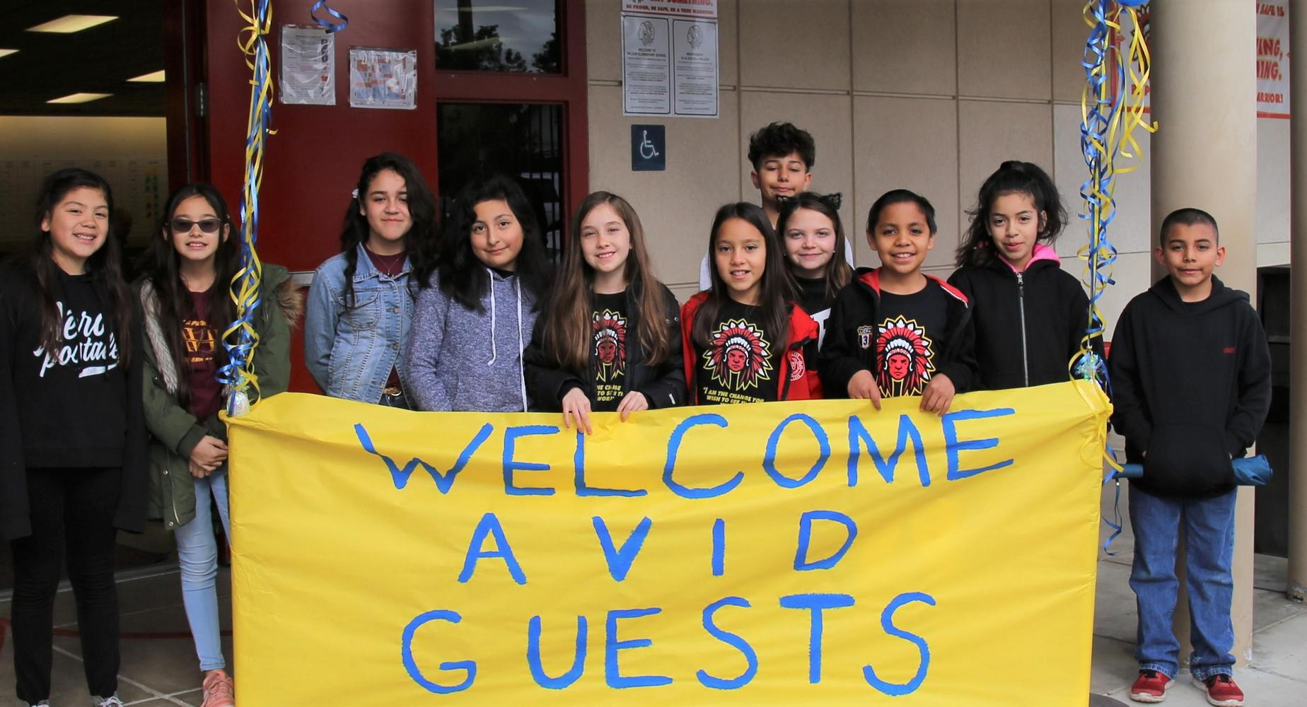 Students Holding AVID Welcome Sign
