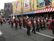 Varsity marching band in a parade at Universal Studios Orlando Florida.