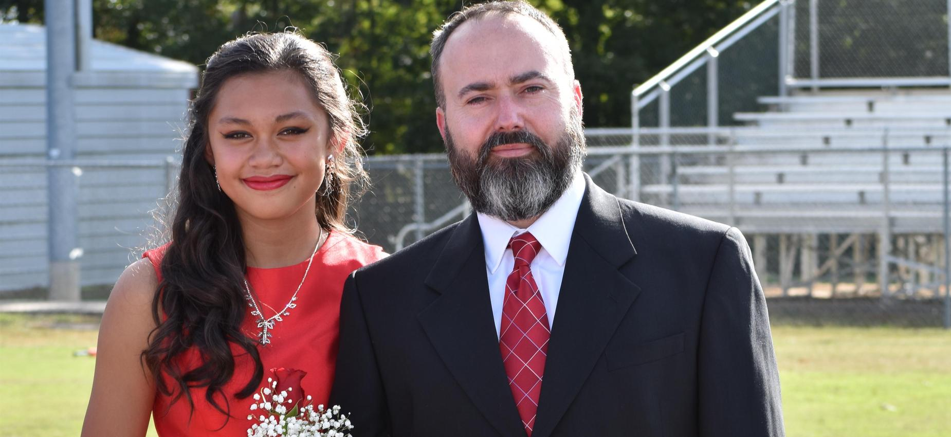 Picture of homecoming maid with escort
