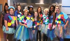 Kindergarten team dressed up like the Rainbow Fish