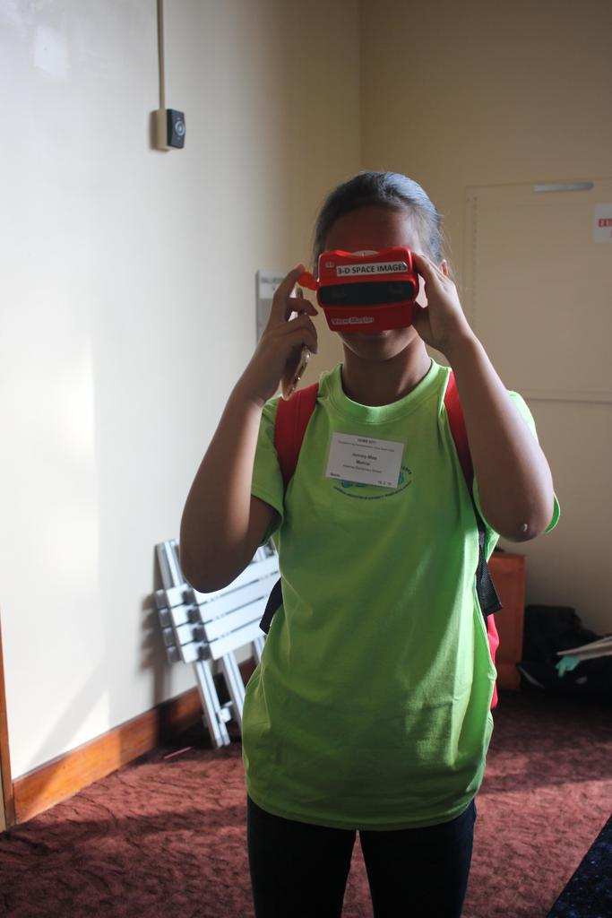 girl looking at 3D space images using viewfinder