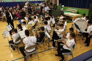 students playing trumpets, tuba, flute, drums