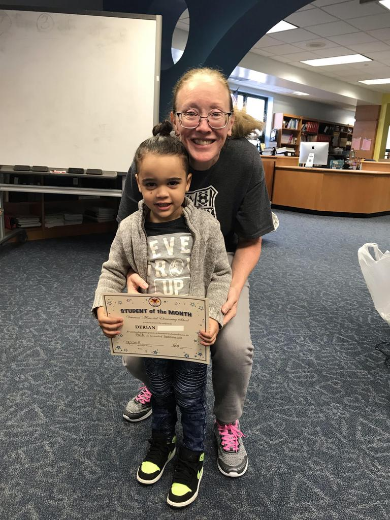 student of the month derian pre-K with principal O'connel