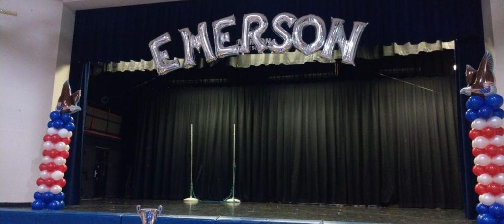 Emerson honors dinner stage decorated with banner and balloons