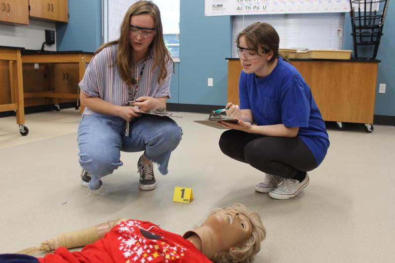 Mara Jackson and Meredith Johnson analyze a mock crime scene