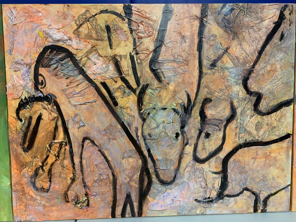 cave painting of animals grazing