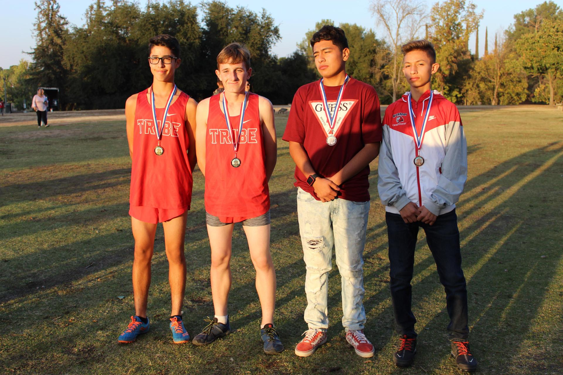 JV Boys winners pose with their medals.