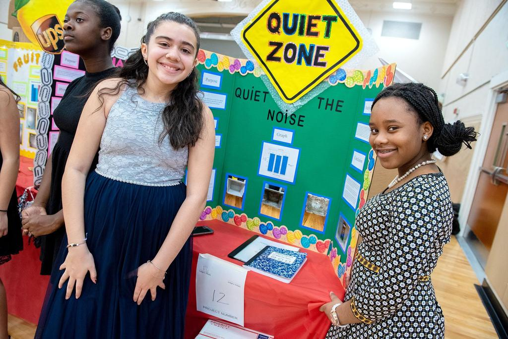 Two students stand in front of their project called Quiet Zone