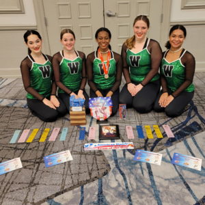 5 teen girls pose in matching leotards with awards they have won