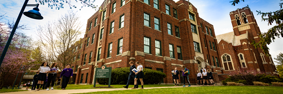 photo of OLSH building with students walking on path