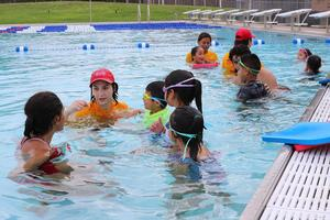 Pictured are Mission Aquatic Center Lifeguards with a Learn-to-Swim students.
