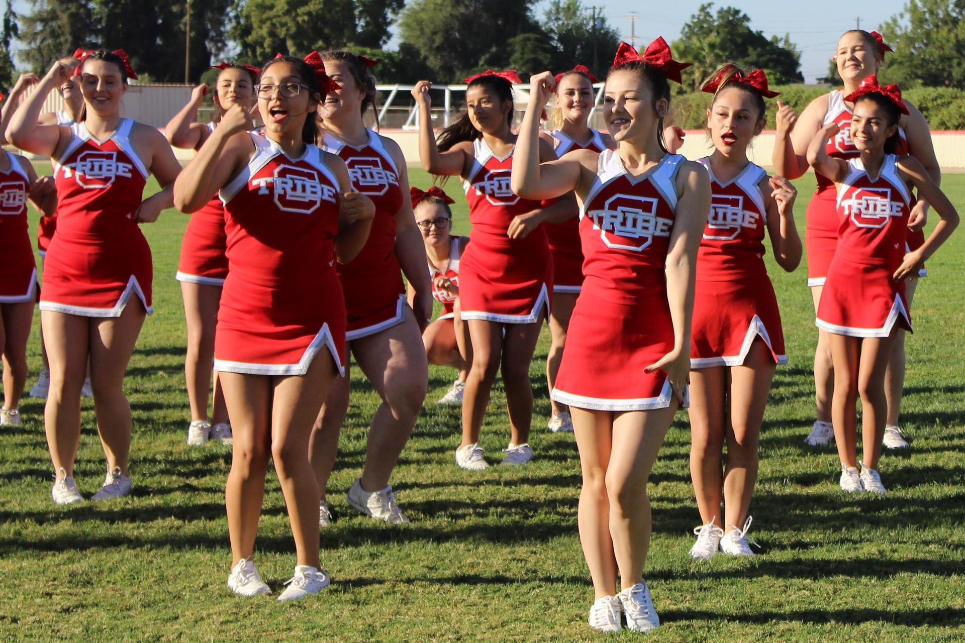 cheerleaders performing a routine.