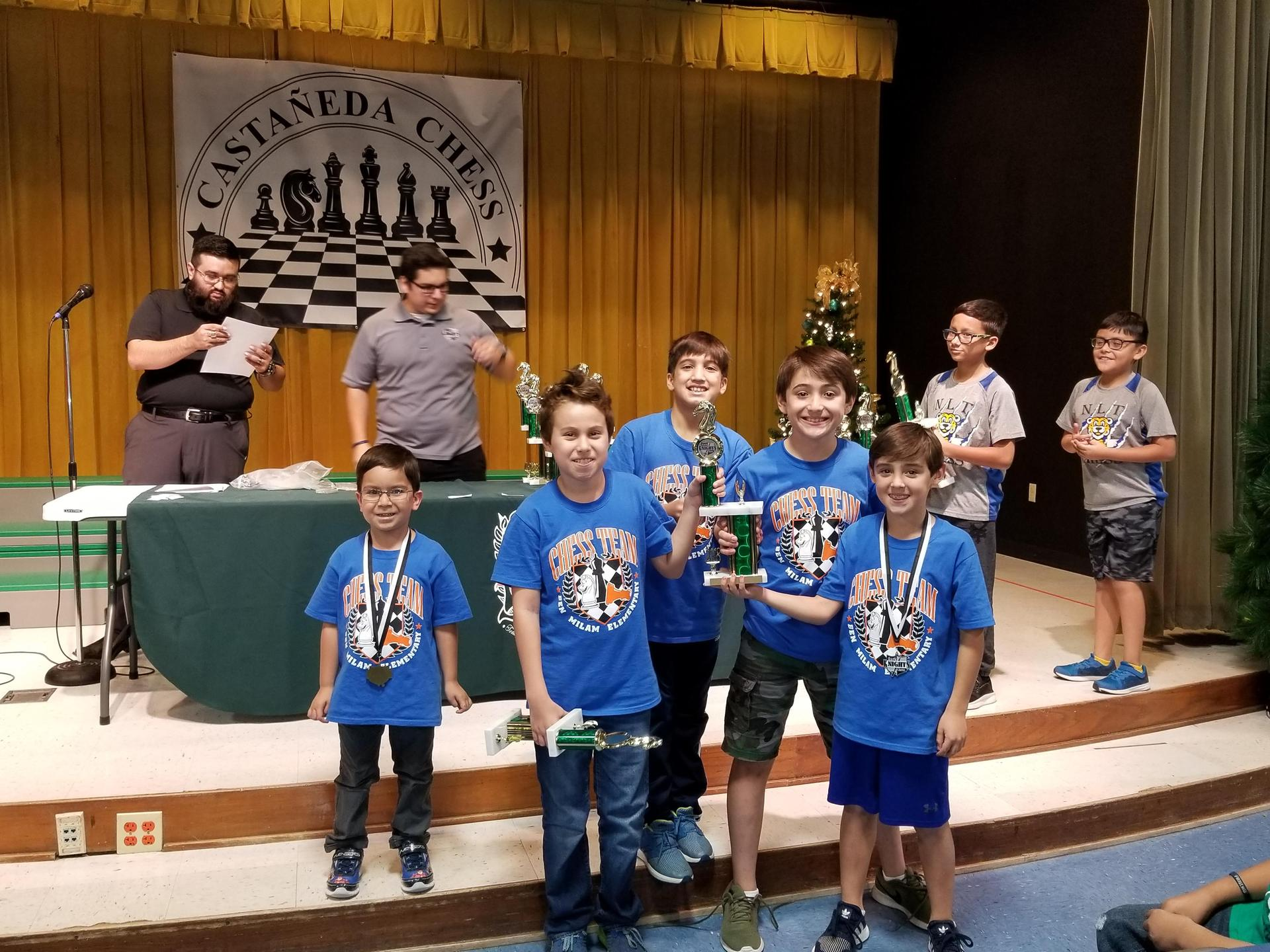 Chess team with trophy.