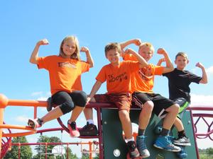 TKHS students climb on the playground at Page.