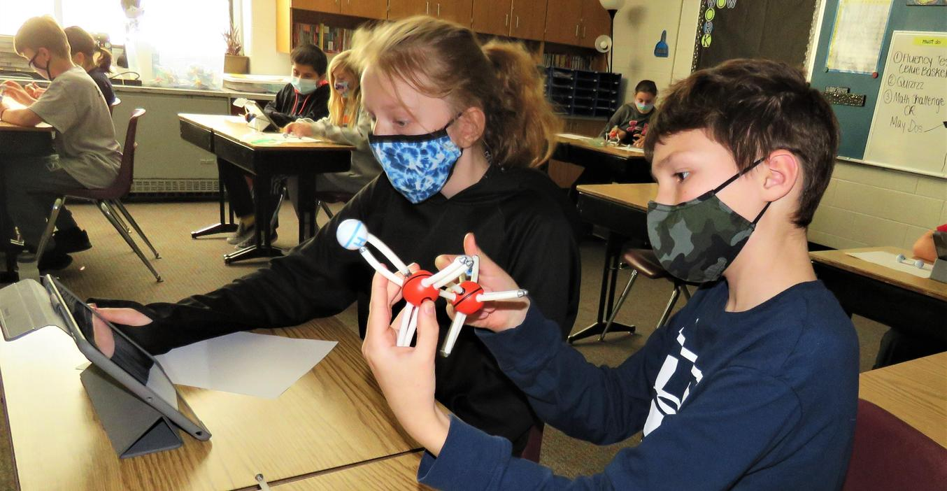 Starbase came virtually to Page students this year and are shown here in a hands on lesson building atoms.