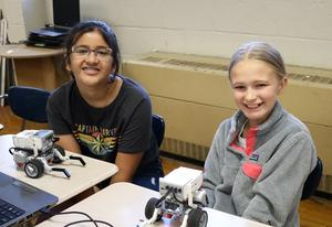 Roosevelt 7th grader Aashma Pant (left) and Edison 6th grader Jenny Butler team up to design and build robots at STEM Camp.