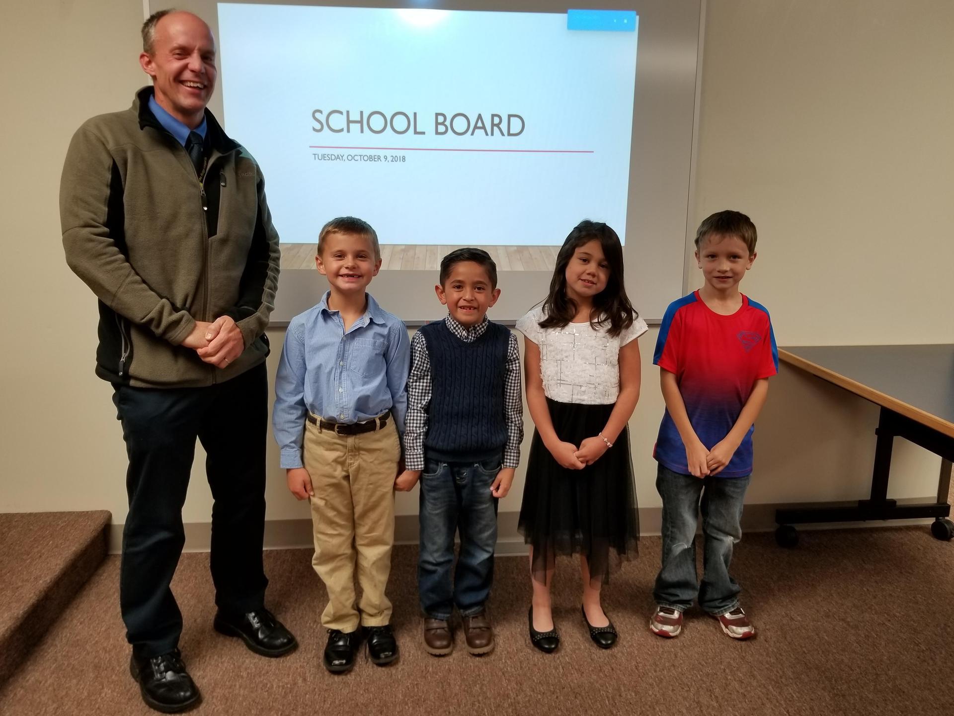 Lake Ridge Principal Steve LaBau poses with students Jude Sears, Alex Alfars, Lana Sim and Camden Burey.