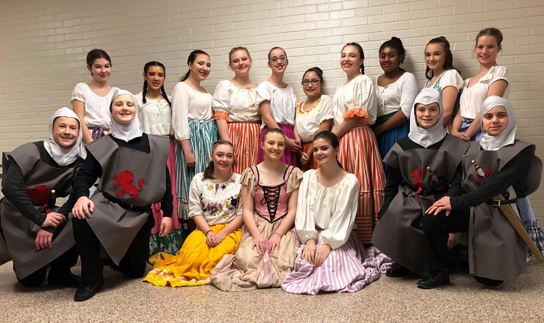 Middle School students, girls and boys, dressed up in costumes ready to perform in high school musical Cinderella.