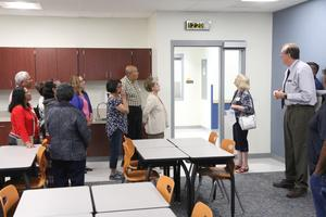 Senior citizens looking at one of the classrooms at Simcoe Elementary