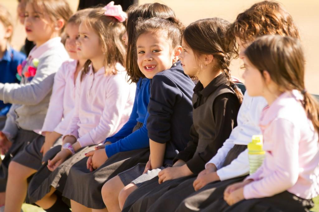 girls sitting outside