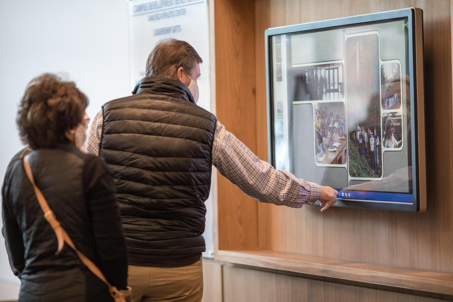 people using the new touch screen display in the athletic center