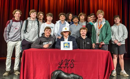 Lacrosse team and Cannon Cooper during signing