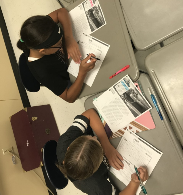 SFJH English Students complete an assignment.