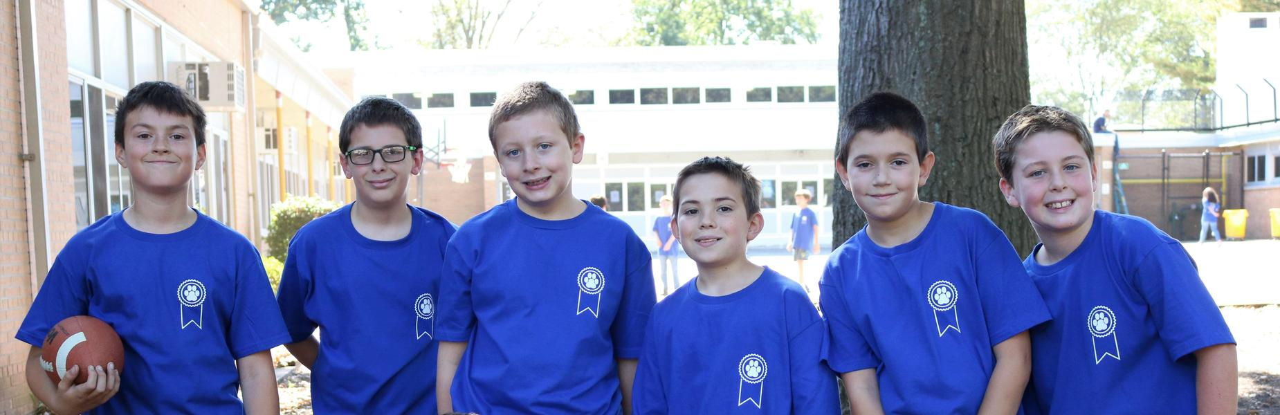 Photo of Washington students wearing National Blue Ribbon shirts.