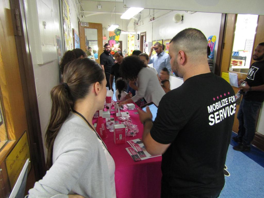 Tmobile representatives greeting parents in the main hallway