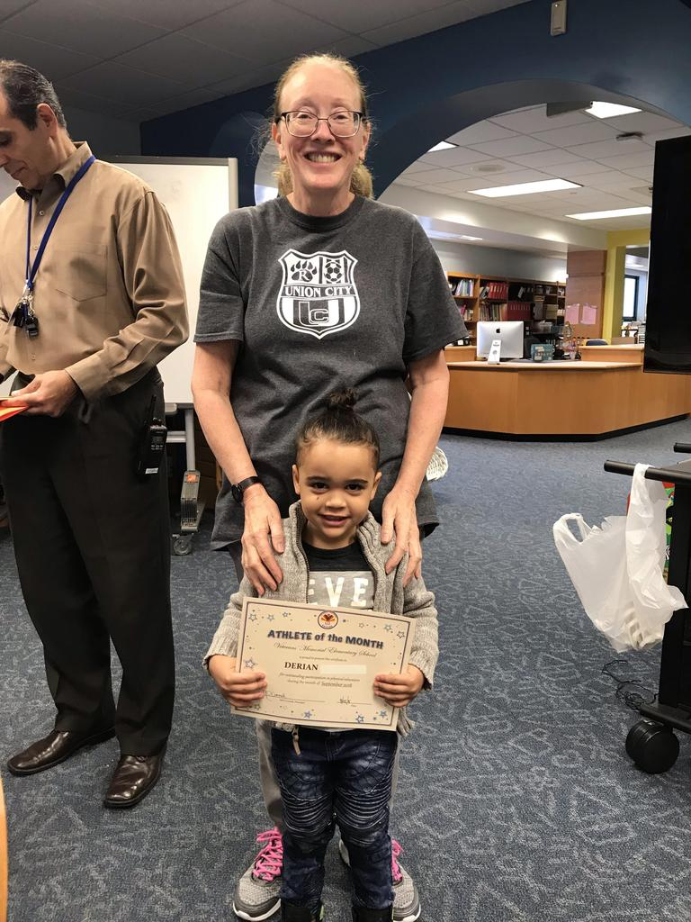 student of the month derian grade pre-k with principal O'connel