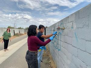 Foothill High students clean up graffiti in neighborhoods as part of Operation Graffiti Cover-up