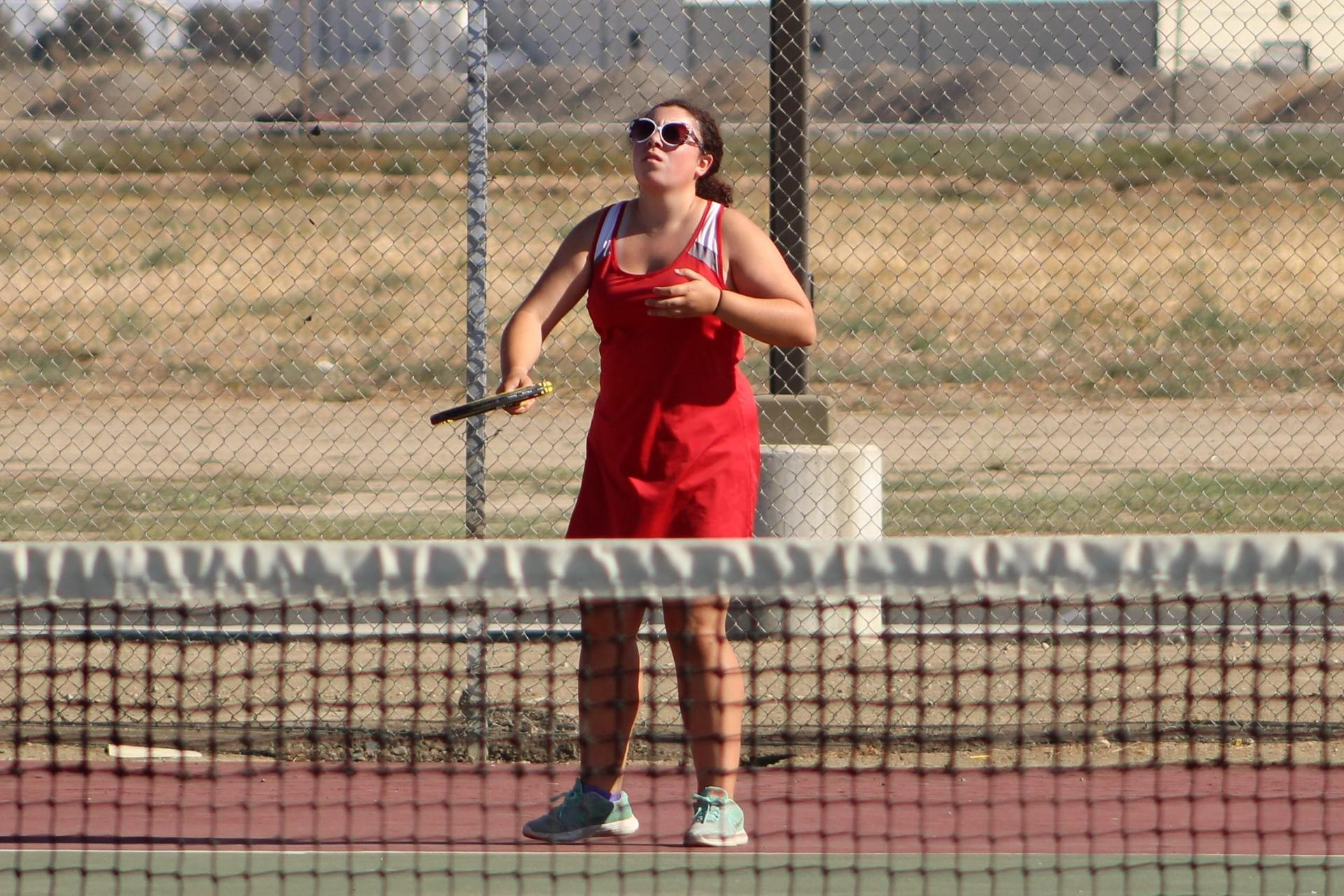 Junior Varsity girls playing tennis against Kerman